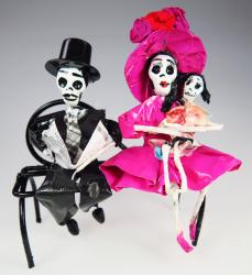 Day of the Dead Calavera family on bench pink