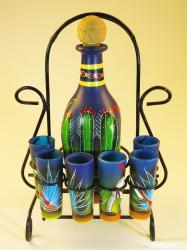 Pancho Agave Tequila Bottle with six shots on blue in Front Rack