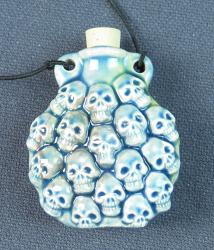 Skull Family clay vessel pendant