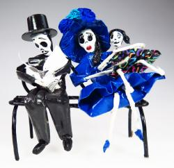 Day of the Dead Calavera family on bench
